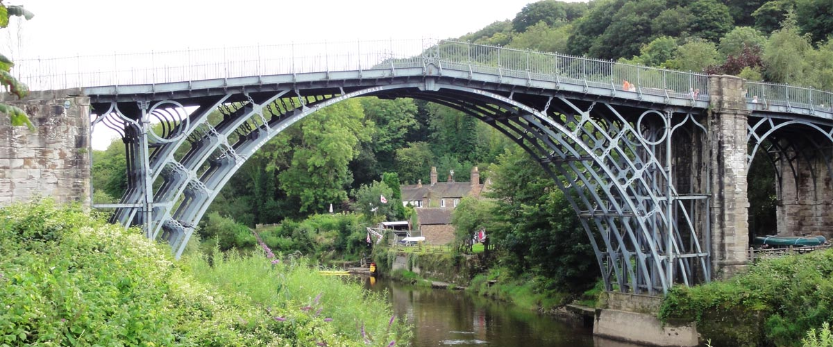 AWE Ltd environmental policy - Iron bridge in Shropshire showing industry harmonising with the environment